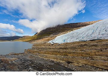 Ice front of Svartisen Glacier in Norway with lake