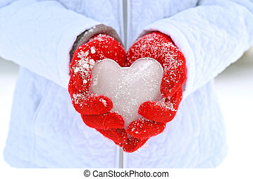 ice heart in red gloves - Girl holding ice heart in bright...