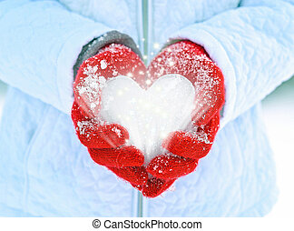 ice heart in red gloves with sparkles