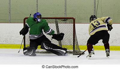 Ice Hockey goaltender makes a save