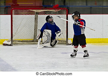 Ice hockey player celebrates after scoring a goal