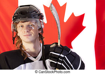 ice hockey player with stick over canadian flag