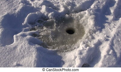 ice-hole for fishing on lake