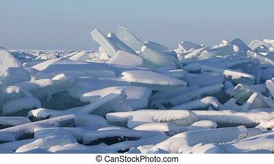 Beautiful landscape with huge ridge of ice hummocks on Lake Baikal in Siberia, Russia