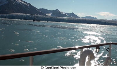 Ice in ocean of Arctic view from ship. Travel in calm and ...