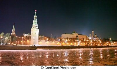 ice in river on foreground and Kremlin at night