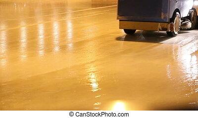 Ice machine. - Ice machine cruises over ice rink and clean...