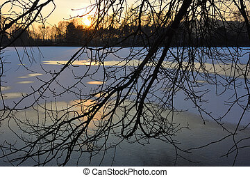 Ice melting on the lake in the sunset. Ice texture