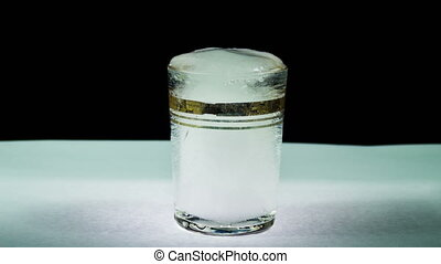 Ice Melts into a Transparent Glass