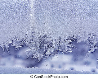 Ice pattern and frozen water drops on glass