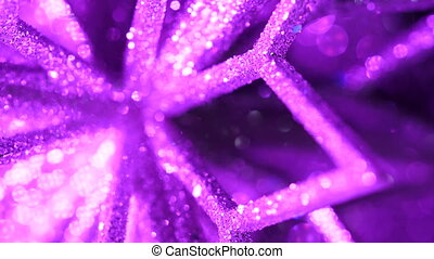Ice pattern close-up view. Winter snowflake macro texture background. Shining glowing christmas tree toy rotating in magic neon violet light. New year festive mood. Slow motion