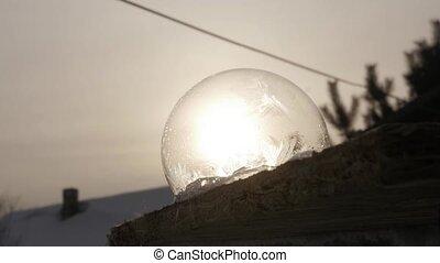 Ice patterns slowly grow on soap bubble. Soap Bubble...