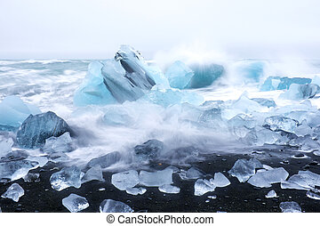 Ice rocks on a black sand beach in Iceland