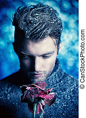 ice rose - Portrait of a handsome man dressed in winter...