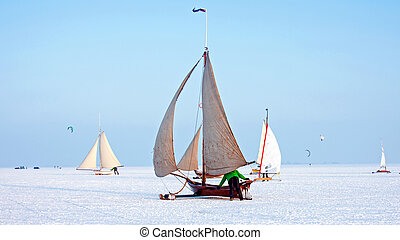 Ice sailing on a cold winter day on the Gouwzee in the Netherlands