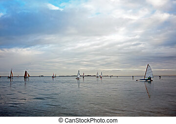 Ice sailing on the Gouwzee in the Netherlands at sunset