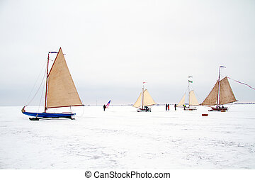 Ice sailing on the Gouwzee in winter in the Netherlands