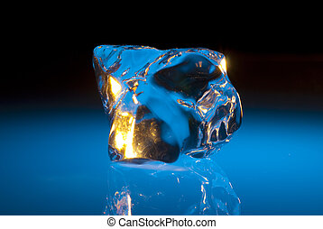 Ice sculpture - chunk of ice on plexiglass photographed with...