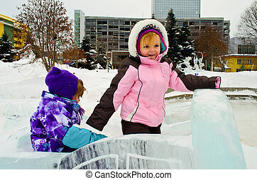 Ice sculpture fun - Two toddlers playing on the ice ...