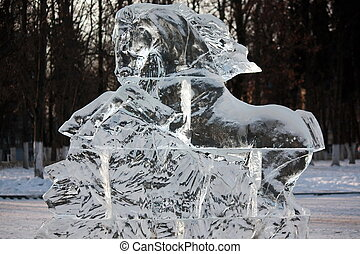 Ice sculpture horse outdoors in the winter .
