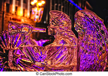 ice sculpture - Ice sculpture illuminated by colored lights ...