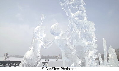 Ice sculpture of children playing with a flying kite . Ice Sculptures in Russia. Sculptures In The Ice town.
