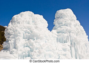 Ice sculpture on blue sky by background