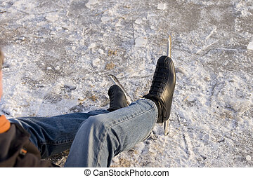 Ice skater sitting on ice