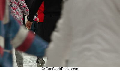 Ice skaters at a public ice skating rink, Rear View