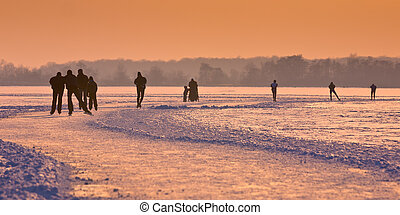 Ice Skaters on frozen lake