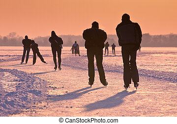 Ice Skaters under setting sun