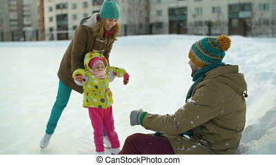 Ice Skaters - Close up of mother supporting child skating...