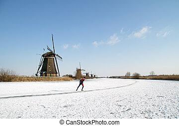 Ice skating at Kinderdijk in the Netherlands - Ice skating...