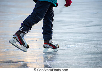 Ice skating at the rink in winter.