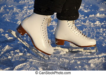 ice skating - Closeup of figure skating ice skates in action...