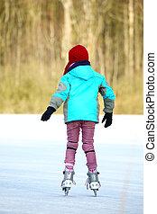 Ice skating girl. Young woman skating