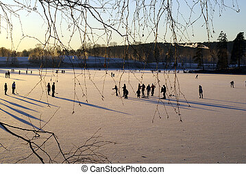 Ice-skating - Ice skaters at the lake Bogstadvannet in Oslo