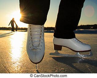 Ice Skating - Ice skating. Ice skates in action closeup...