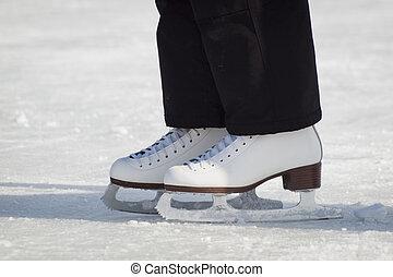 Ice Skating - Ice skating on Evergreen Lake in Evergreen,...