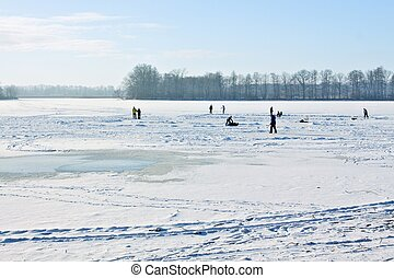 Ice-skating on frozen lake
