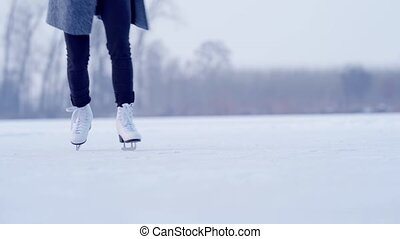 ice skating on the ice of a frozen lake.