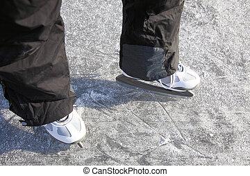ice skating outdoors pond freezing winter