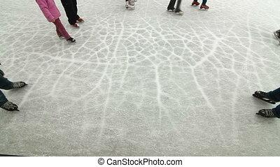 ice skating people at a public ice skating rink