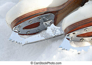 Ice skating shoe - Close up of ice skating shoe at frozen...