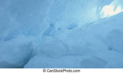 Ice, snow covered cave of Antarctica. Polar shot.