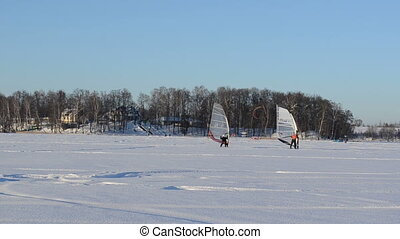 ice surfer sailer winter - ice surfers men sailing on frozen...