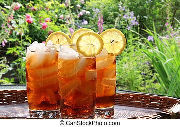 Ice tea - Summer lemon ice tea in the garden.