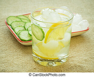 Ice water, lemon, ginger root and cucumber.
