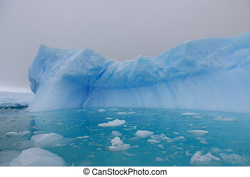 Iceberg and azure water in Antarctica