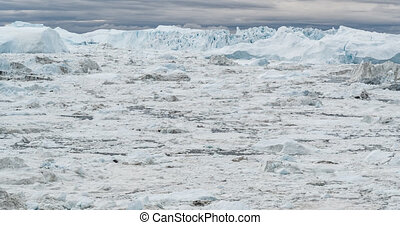 Iceberg and ice from glacier in arctic nature landscape on Greenland